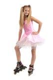 Jeune fille sur des lames de rouleau Image libre de droits
