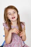 Jeune fille sur la chaise Photo stock