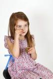 Jeune fille sur la chaise Images stock
