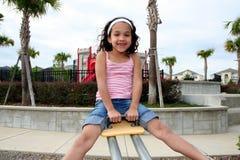 Jeune fille sur la cour de jeu Photographie stock