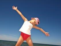 Jeune fille sur la plage Images stock