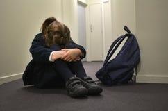 Jeune fille triste d'école photo stock