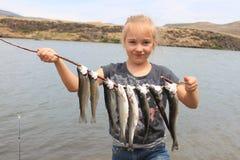 Jeune fisherwoman photo stock