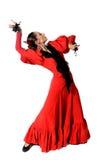 Jeune flamenco espagnol de danse de femme avec des castagnettes dans des ses mains Photographie stock