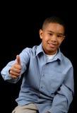 Jeune garçon affichant l'approbation Photographie stock libre de droits