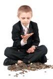 Jeune garçon avec de l'argent. Images stock