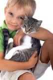 Jeune garçon avec le chat photographie stock