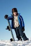 Jeune garçon avec le Snowboard Photo libre de droits