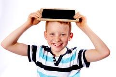 Jeune garçon avec le tableau Photographie stock libre de droits