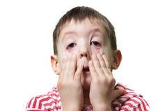 Jeune garçon effectuant des visages Image libre de droits