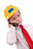 Jeune garçon mignon d'entrepreneur sur la cellule Photo stock