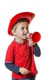 Jeune garçon mignon dans un costume de pompier images stock