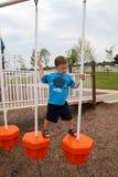 Jeune garçon sur Playscape Image libre de droits