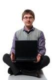 Jeune gestionnaire avec l'ordinateur portatif Images libres de droits