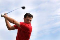 Jeune golfeur avec le gestionnaire Images libres de droits