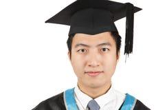 Jeune graduation asiatique d'homme Photo stock