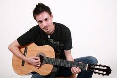 Jeune guitariste - Jon photographie stock libre de droits