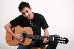Jeune guitariste - Jon Images libres de droits