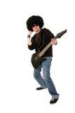 Jeune guitariste soulevant son poing Photographie stock libre de droits