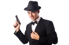 Jeune homme élégant jugeant le pistolet d'isolement dessus Photographie stock libre de droits