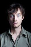 Jeune homme étonné avec l'expression faciale choquée Images libres de droits