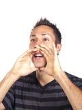 Jeune homme appelant à quelqu'un Image stock