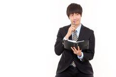 Jeune homme asiatique d'affaires Images stock