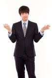 Jeune homme asiatique d'affaires avec l'ennui Images libres de droits