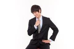 Jeune homme asiatique d'affaires avec la tension Image stock