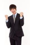 Jeune homme asiatique heureux d'affaires Image stock