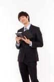 Jeune homme asiatique heureux d'affaires Photo libre de droits