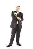 Jeune homme attirant avec des orchidées de fleurs Photographie stock libre de droits