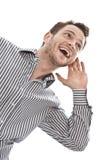 Jeune homme attirant heureux d'affaires dans l'isolant de écoute de chemise bleue photos stock