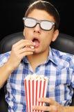 Jeune homme au cinéma Photographie stock libre de droits