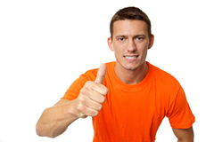 Jeune homme au doigt orange de t  photo stock
