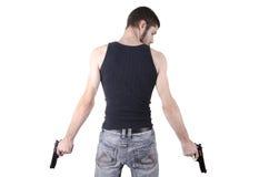 Jeune homme avec des canons photographie stock libre de droits