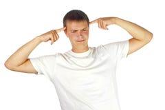 Jeune homme avec des doigts sur la tête Photos stock