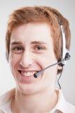 Jeune homme avec l'écouteur Images libres de droits