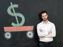 Jeune homme avec l'argent d'économie de barbe Image libre de droits