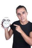 Jeune homme avec l'horloge d'alarme Photo libre de droits