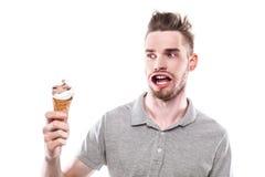 Jeune homme avec la bouche ébouriffée par le vent Photo libre de droits