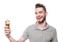 Jeune homme avec la bouche ébouriffée par le vent Photo stock