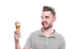 Jeune homme avec la bouche ébouriffée par le vent Photographie stock libre de droits