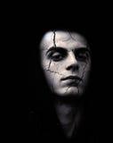 Jeune homme avec la peau criquée photo stock