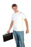 Jeune homme avec le boîtier en plastique noir sur le blanc Image libre de droits