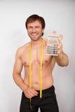Jeune homme avec le mètre Photo stock