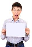 Jeune homme avec le papier Image stock