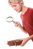 Jeune homme avec le portefeuille vide Image stock