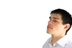 Jeune homme avec les yeux fermés Photographie stock libre de droits