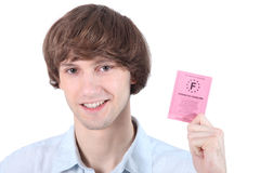 Homme avec son permis de conduire Photographie stock